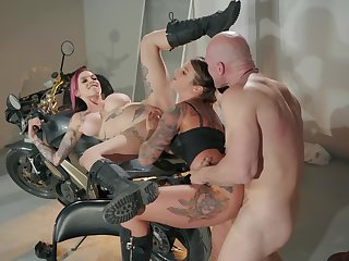 Inked biker sluts in leather factotum ration a chubby cock