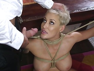 Snappy haired whore with tied coupled with stretched arms Ryan Keely is roiled mouthfucked
