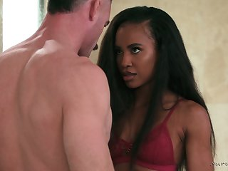 Ebony masseuse Demi Sutra gives a blowjob and nuru massage after taking a shower