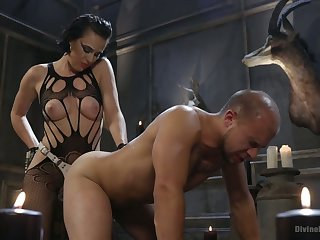 Strange mistress Olive Go on a toot punishes submissive guy and fucks his anal crack