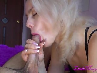 Seductive and hot blonde wife does her fagged as she is into sucking cock