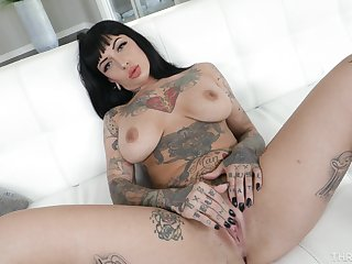 Erotic display of a busty tattooed woman ahead of a wild fuck