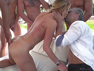 Light-complexioned starlet fucked hard and covered in cum during hardcore gangbang