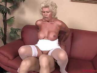 Mature blonde woman with firm tits is about alongside have sex with a younger guy