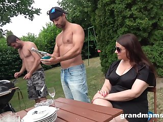 Middle aged cookie is fucked apart from two young hot guys in dramatize expunge garden