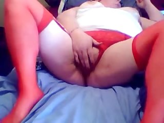 Naff red haired BBW hooker is masturbating her twat for me