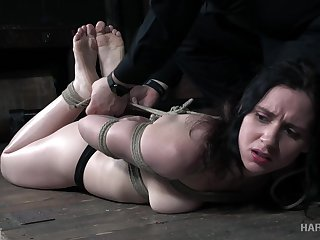 Tied up Audrey Holiday gets her pussy toyed unlettered BDSM room