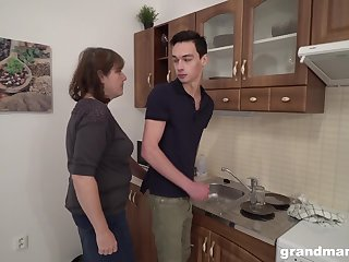 Sex-starved grey landlady bangs young tenant right in the kitchen