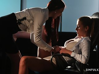 Sexually charged lesbians are making love in the dim light