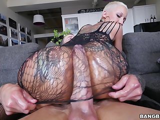 Tattooed pornstar Bella Bellz drops the brush thong for anal sex